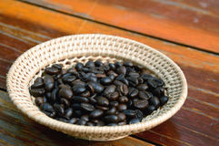 Coffee beans. In basket on wooden background Royalty Free Stock Photography