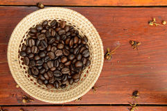 Coffee beans. In basket on wooden background Stock Photos