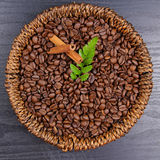 Coffee beans. In baskets on black background Stock Photo