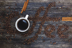 Coffee beans. Beautiful title Coffee written of coffee beans on wooden table Stock Images
