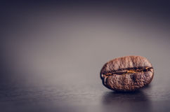 Coffee beans on a black background. Levitation coffee beans. Grained product. Hot drink. Close up. Harvesting.Natural background. Royalty Free Stock Photos