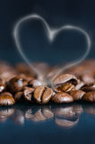 Coffee beans on a black background. Raw coffee beans. Grained product. Hot drink. Close up. Harvesting. Natural background. Energy Royalty Free Stock Image
