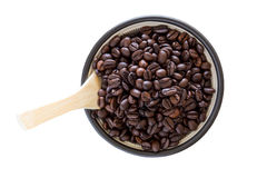 Coffee beans in black ceramic bowl Stock Images