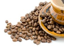 Coffee beans and black coffee in a cup royalty free stock photos