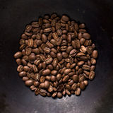 Coffee beans on black steel background. Fragrant fried coffee beans. Top view Stock Image