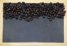 Coffee beans and blackboard Stock Photography