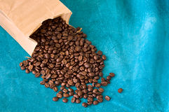 Coffee beans on blue Royalty Free Stock Photo