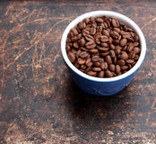 Coffee beans in blue bowl Stock Images