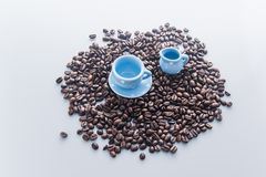 Coffee beans with blue espresso dishware Stock Images