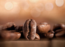 Coffee beans on blurred background Royalty Free Stock Photos