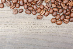 Coffee beans border on old oak table. Royalty Free Stock Photos