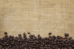 Coffee Beans Border over Burlap Stock Images