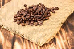 Coffee Beans Border over Burlap Royalty Free Stock Photography