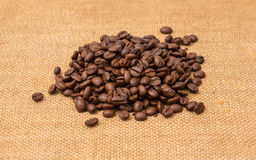 Coffee Beans Border over Burlap Royalty Free Stock Image