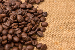 Coffee Beans Border over Burlap Stock Photography