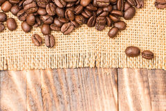 Coffee Beans Border over Burlap Royalty Free Stock Images