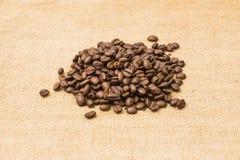 Coffee Beans Border over Burlap Stock Photos