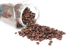 Coffee beans. And bottle on white background Royalty Free Stock Images