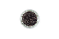 Coffee beans in bottle on white background Royalty Free Stock Photo