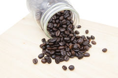 Coffee beans in bottle on wood block. Thailand Stock Image