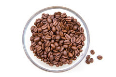 Coffee beans on the bowl from above. Coffee beans on the bowl on a white background seen from above Royalty Free Stock Photography