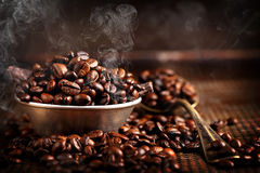 Coffee beans in a bowl on brown vintage background Stock Image