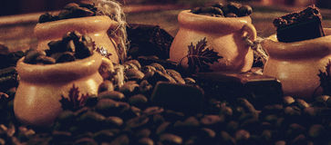 Coffee beans in a bowl of chocolate bars Royalty Free Stock Images