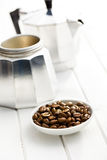 Coffee beans in bowl with coffee maker Royalty Free Stock Image
