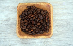 Coffee beans in bowl and coffee Royalty Free Stock Photography