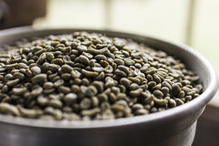Coffee beans in bowl Stock Image