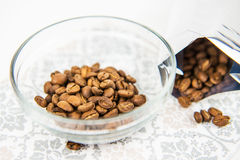Coffee beans in bowl Stock Images