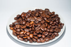 Coffee. Beans in a bowl on a white background royalty free stock image