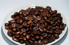 Coffee. Beans in a bowl on a white background royalty free stock photo