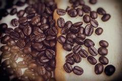 Coffee beans vintage tone, art work background. Coffee beans and Bread vintage tone, art work background,Retro Style Royalty Free Stock Photos