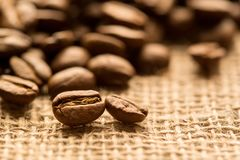 Coffee beans. Dark background with copy space, close-up stock images