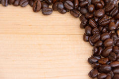 Coffee beans on brown background. Coffee beans texture lay on brown background royalty free stock image