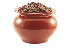 Coffee beans in a brown clay pot isolated Stock Photo