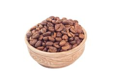Coffee beans in brown cup. Isolated on white background Royalty Free Stock Image