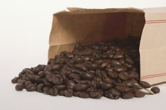 Coffee Beans in a Brown Paper Bag Stock Images