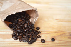 Coffee beans in brown paper bag Royalty Free Stock Photos