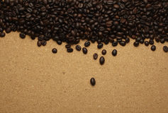 Coffee beans on brown paper, can be used as a back Stock Image
