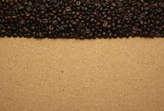 Coffee beans on brown paper, can be used as a back Stock Photography