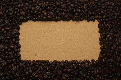 Coffee beans on brown paper, can be used as a back Royalty Free Stock Images