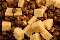 Coffee Beans and Brown Sugar Cubes Stock Images