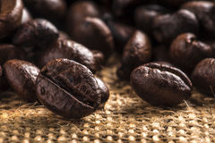 Coffee beans and brown wall Stock Photos