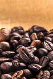 Coffee beans and brown wall Royalty Free Stock Photos