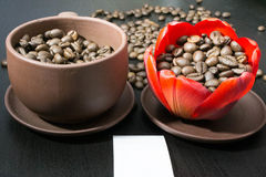 Coffee beans in the bud red flower, paper with your signature.  Royalty Free Stock Image