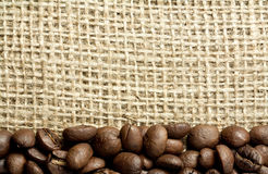 Coffee beans on burlap Stock Photography