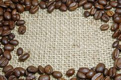Coffee beans on burlap Stock Images