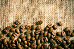 Coffee beans on burlap background Stock Photography